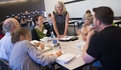 Alyson Stanfield talks with artists at her art business workshop. Photo by Rafael Aguilera.